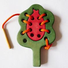 Shop Wooden Lacing Toys on Wanelo