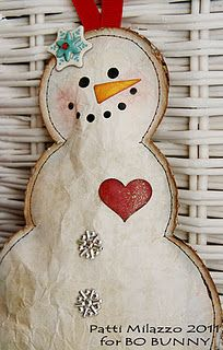 Make this cute snowman with paperbags.  Or adapt it to burlap!