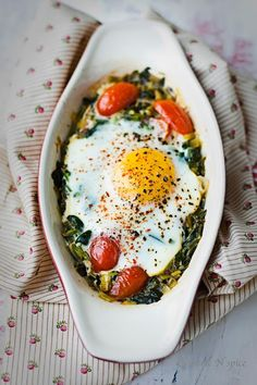 Baked spinach, egg and tomato.