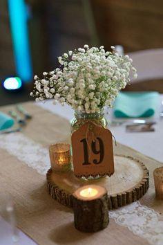 Rustic Baby Breath Wedding Centerpiece / http://www.himisspuff.com/rustic-wedding-centerpiece-ideas/7/