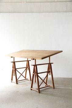 Antique french atelier wood adjustable sawhorse studio work table.