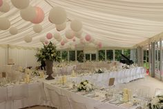 Soft pinks, whites and cream paper lanterns in a beautiful Wedding Marquee by Pavilion