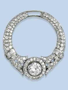 AN ART DECO DIAMOND CLIP BROOCH, CIRCA 1920. Of circular shape, designed as two opposing palmette-shaped motifs set throughout with circular-cut diamonds and baguette diamond bands, centring a larger brilliant-cut diamond. #ArtDeco #clip #brooch