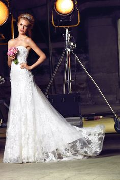 Stunning lace strapless wedding dress with overlay design is traditional but modern at the same time