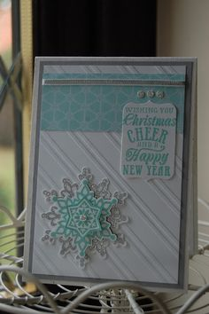 Stampin'spiration: Festive Flurry stamp set and Framelits, Christmas Messages stamp set, Stylish Stripes TIEF,   Colors:  Smoky Slate, Coastal Cabana, Whisper White, Silver Encore stamp pad with clear embossing powder, Silver glimmer paper, silver ribbon all from Stampin' Up!