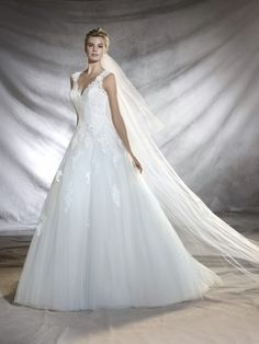 Just look at this beautiful lace ballgown! Available at Spotlight Formal Wear! #SpotlightBridal