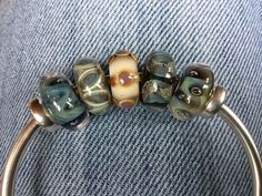Trollbeads Rocky beach bangle with azure bubbles, sandstone, sea urchin and cliffs