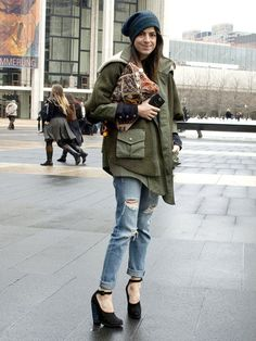 This outfit is epic on so many levels. Love the military with the ripped denim. #Elle