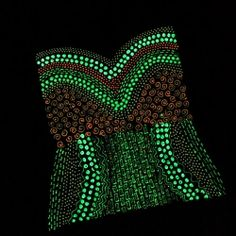 Super clever project idea using a plain black fitted t-shirt and Glow paints. When the lights are off it looks like a glowing corset!