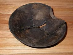 One of several wooden bowls and dishes found on the site of the medieval hospital of St Mary Spital. Some are scratched with marks, possibly to show they belonged to particular patients.  Production Date: Medieval; late 13th century