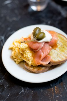 Soft-scrambled eggs with smoked salmon, caper berries and grilled toast, at Buvette NYC.