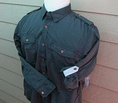 A nice shirt with a bunch of Brass Button Works .45 Auto buttons added... www.brassbuttonworks.com