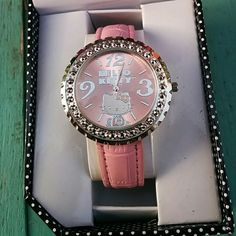 GIFT IDEA HELLO KITTY WATCH Pink Hello Kitty watch. Band new in box.. Can not show back because it is still attached to the box.  Working battery. Great gift for the Hello Kitty fan in your life. Sanrio Accessories Watches