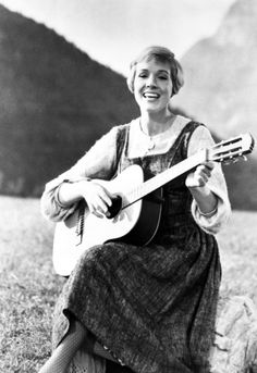 The Sound of Music (1965) starring Julie Andrews playing a classical acoustic guitar.