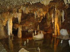 Meramec Caverns is the collective name for a 4.6-mile cavern system in the Ozarks, near Stanton, Missouri. The caverns were formed from the erosion of large limestone deposits over millions of years.