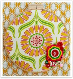 good use of favorite fabric for wall hanging