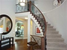 Curved wrought-iron staircase and hardwood floors  www.heatherdavis.ca