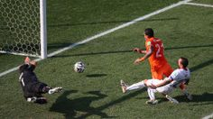 Memphis Depay of the Netherlands shoots and scores his team's second goal against Chile