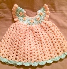 Isn't this the sweetest feminine and delicate  newborn dress?  Are you expecting a baby girl?  This pinafore angel wing dress would make a great homecoming from the hospital dress.  Handmade crochet with flower and pearl embellishments and buttons down the back.  Could also be used for a photo shoot or baby shower!
