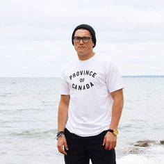 Boys on the beach wearing toques.  | Province of Canada | provinceofcanada.com