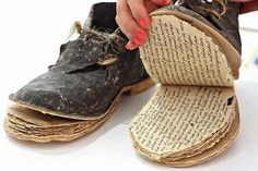 Book by ©Magdalena Haras who has taken excerpts from 'The long Walk' bySlawomir Rawicz and made them into a book that is also a pair of shoes. http://korespondencja.bookart.pl/en/books/two_stages_of_the_memoir.html