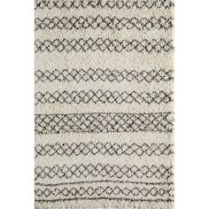 """This collection invites the sense of touch with a cozy 2"""" pile height. Inspired by Morocan Berber carpets, this design is perfect for casual, modern and transitional spaces. Power-loomed construction using several strands of polypropylene."""
