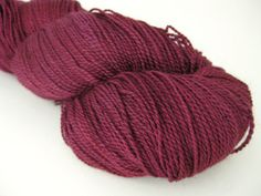 Two things I like~good yarn and a glass of wine.