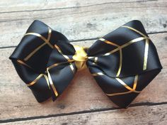 Large Black and gold double loop Bow headband | feather | vintage | eligant | tribal | stripe by ShopSassyBabes on Etsy https://www.etsy.com/listing/250015517/large-black-and-gold-double-loop-bow