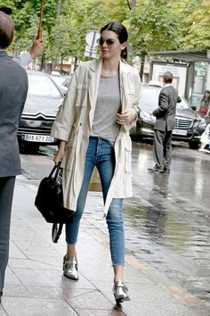 Very fitting for Paris, Jenner spices up a classic trench and jeans look with a flashy pair of metallic ankle boots.