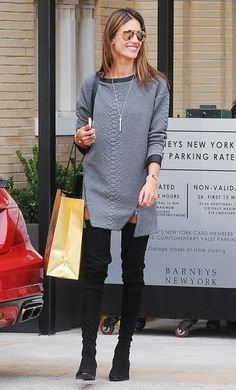 Alessandra Ambrosio wearing a long grey sweater dress with zip detail and black over-the-knee boots