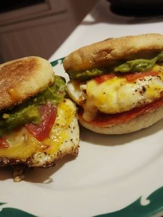 [29883984] This is my favorite breakfast sandwich to make; Hot Genoa Salami Guacamole melted Swiss on a fried egg all between a toasted English muffin.