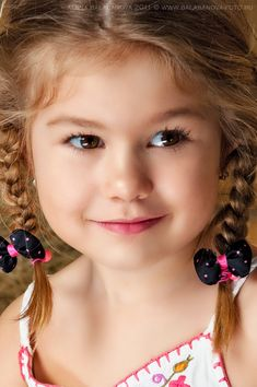 A closeup of a beautiful little girl with braids. www.SeedingAbundance.com http://www.marjanb.myShaklee.com