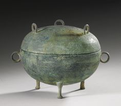 A BRONZE RITUAL FOOD VESSEL AND COVER (DING OR DUI)  WARRING STATES PERIOD