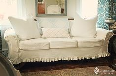 Drop cloth slipcover for couch for homeschool room....love the cute pleated skirt detail!