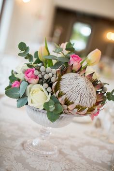 #protea, #centerpiece Photography: Adene Photography - adenephotography.co.za Floral Design, Decor + Coordination: Special Events - eventsplanner.co.za Read More: http://www.stylemepretty.com/2013/02/06/south-africa-wedding-from-adene-photography/
