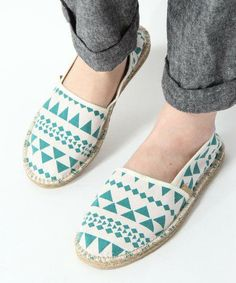 Rolled pant legs and printed TOMS shoes. Show them off in a summery casual way!