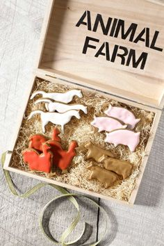 """Traditional gingerbread takes a walk on the wild side, via critter cookie cutters. Corral the whole stable in a hand-stenciled box filled with """"hay."""""""