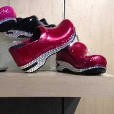 Red rhinestone danskos :) I lalso love the pink ones in the background!! gotta find these!!