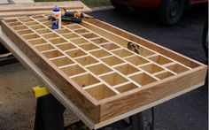 Torsion box for perfectly flat workbench top made using a wood grid and a top and bottom of plywood