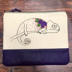 One of a kind handmade chameleon print clutch purse. Roomy, fully lined and comes with its own linen dust bag for storage!
