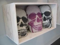 skull pillows ... What if they were day of the dead skulls?