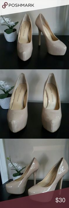 """Like New! Chinese Laundry Nude Platforms sz 7.5 True to size, A must have if you love high heels. Beyond sexy,  will compliment just about your entire wardrobe. Like new condition, I'm a size 7 unless shoe runs small.  I only wore around the house trying to see if I could keep them but nope my heel would come off when I walk. You can see from bottom they look almost new. See 4th pic left foot small barely there mark. Having said that, these are Gorgeous.  Heel little shy of 6"""" Front hidden…"""