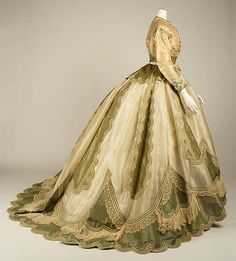 Evening dress, circa 1865, silk, French, label: Mme Marguerite, Robes, Paris. Another great Victorian example in storage at the Met.