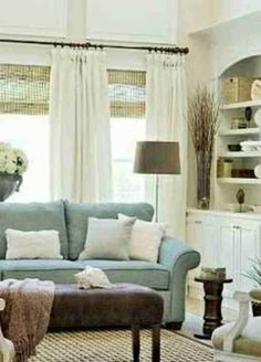 Love love love the layered (and natural) look of blinds and curtains together here!!