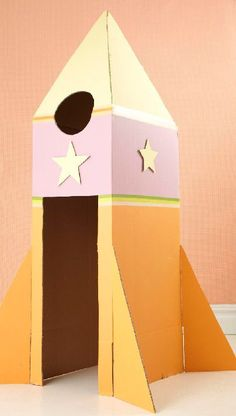 Such a cute cardboard box upcycling idea - cardboard rocket for encouraging creativity in kids! Kids Crafts, Projects For Kids, Diy For Kids, Craft Projects, House Projects, Cardboard Rocket, Cardboard Box Crafts, Cardboard Crafts, Cardboard Box Ideas For Kids