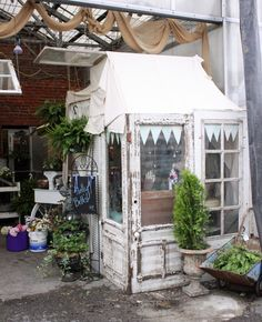 Booth constructed out of old doors and windows, very charming!