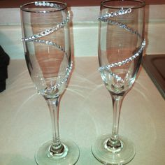 Champagne Glasses I put rhinestones on for my wedding party