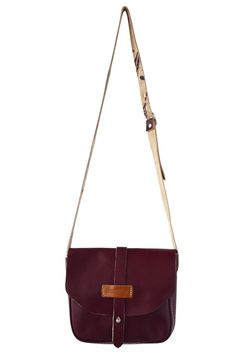 """Oxblood red shoulder bag with clasp closure and adjustable strap. The raw unlined leather adds an artistic touch.  Measures 8.5 wide x 7 high x 2.5 deep strap adjusts to 19-21"""".  Leather Shoulder Bag by cueropapel&tijera. Bags - Cross Body Memphis Tennessee"""