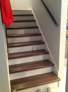 How to redo stairs for cheap - Give your outdated staircase a gorgeous new look! This is a cheater version (little scraping / little painting) that uses wood caps on top of your existing stairs. Redo Stairs, House Stairs, Carpet Stairs, Stair Redo, Basement Stairs, Open Basement, Room Carpet, Rustic Basement, Stairs