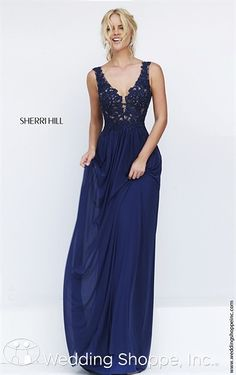 A long flowing chiffon prom dress from Sherri Hill with v-neckline in navy blue.